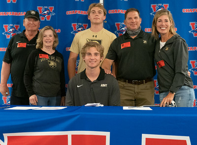 Christian Fournier (C) celebrates with his family after signing to play Lacrosse at The United States Military Academy, during the college signing day at Westlake High School on April 14, 2021. [PAUL BRICK]