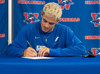 Brooks Jeffers signs to play Lacrosse at The Air Force Academy during the college signing day at Westlake High School on April 14, 2021. [PAUL BRICK]