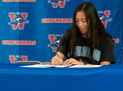 Annie Huang signs to run Cross Country/Track at John Hopkins University during the college signing day at Westlake High School on April 14, 2021. [PAUL BRICK]
