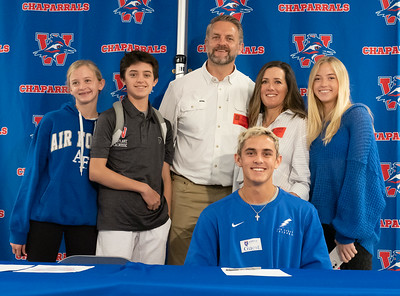 Brooks Jeffers celebrates with his family after signing to play Lacrosse at The Air Force Academy, during the college signing day at Westlake High School on April 14, 2021. [PAUL BRICK]