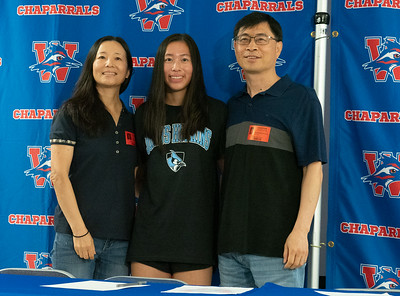 Annie Huang celebrates with her family after signing to run Cross Country/Track at John Hopkins University during the college signing day at Westlake High School on April 14, 2021. [PAUL BRICK]