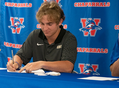 Christian Fournier signs to play Lacrosse at The United States Military Academy during the college signing day at Westlake High School on April 14, 2021. [PAUL BRICK]