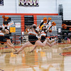 Jumping in the air, senior Lilly Riddell dances with her teammates Feb. 9 in the Main Gym. Junior Meg Freeman and sophomore Alexis petry choreographed the dance.
