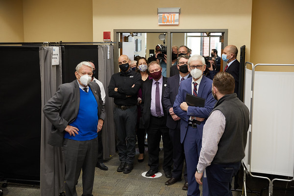 La Crosse Health Deptment gives Govenor Tony Evers UW System President Tommy Thompson a tour of the COVID19 vaccine clinic at UWL.