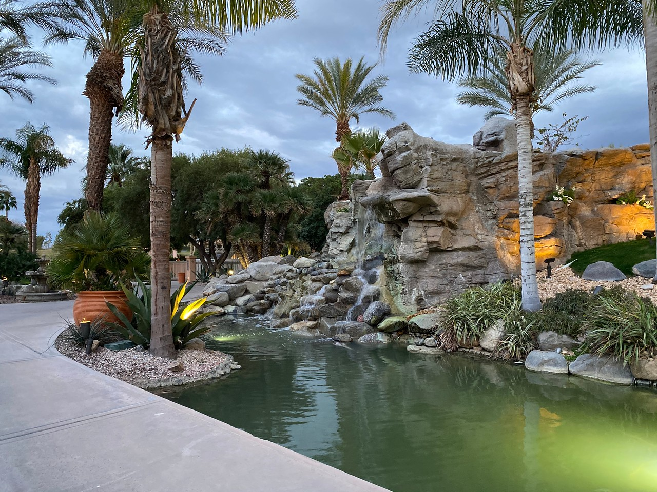 view of pond and fountain at resort