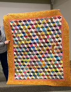 John Putnam showed us a Tumbling Block quilt that he pieced and machine quilted.  Y seams are not so scary.