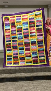Dots Great Chinese Coin quilt.  Pieced and machine quited by John Putnam.  Chinese coin style quilt and he used a Jelly Roll that was called Dots Great.