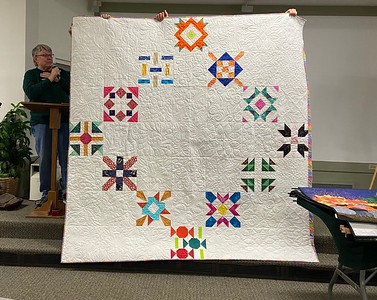 """John Putnam showed us a quilt that was part of a block exchange at the guild in the """"Chocolate Kitchens""""."""