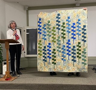 Jean Carlson with her Lupine quilt based on pattern by Gudrun Erla.  Gudrun was at the guild in October.