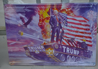 This banner on display outside a Trump rally in Wildwood, N.J., features the President holding an automatic weapon while riding atop a tank.