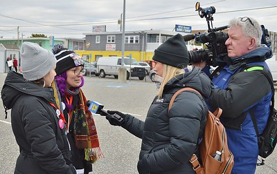 Local TV reporter interviews these young women who were part of the protest against President Trump who was to speak later at a nearby convention center in Wildwood, N.L.