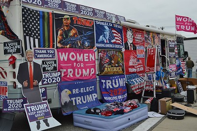 Some of the pro-Trump hats, shirts and banners for sale at a Trump rally in Wildwood, N.J.