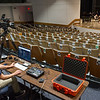 Ciminelli Hall Manager Andrew Borchik testing web streaming equipment during Jazz Ensemble class rehearsal at SUNY Buffalo State College.
