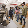 Assistant Professor Arjun Pathak working with EURO undergraduate student researchers in physics lab at SUNY Buffalo State College.