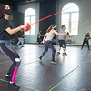 Students working in Lecturer Adriano Gatto's Stage Combat II class at SUNY Buffalo State College.