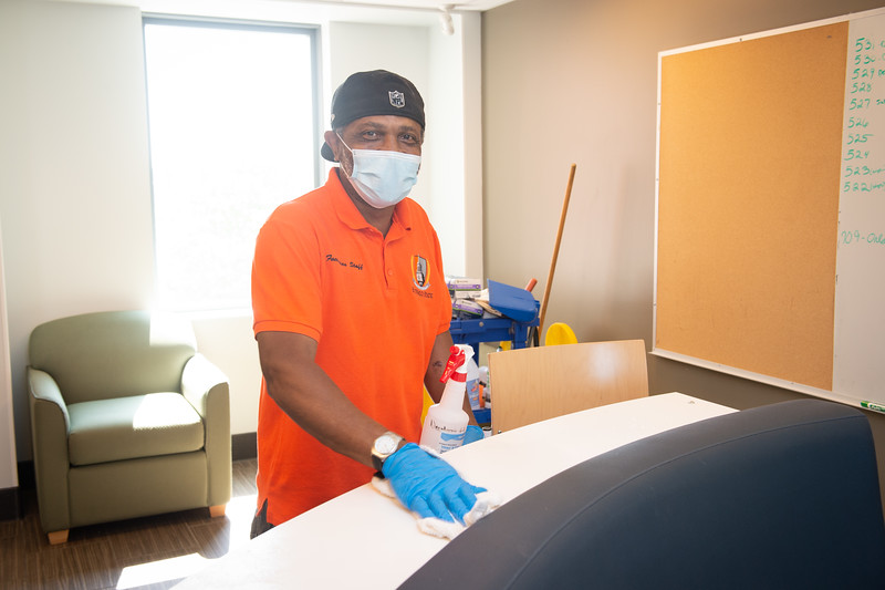 Custodians and cleaners cleaning residence halls at  SUNY Buffalo State College.
