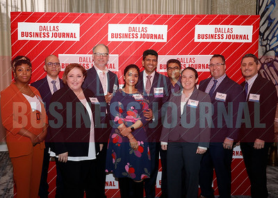 UWorld colleagues celebrate with Minority Business Leader award  winner, Dr. Chandra S. Pemmasani, (center).