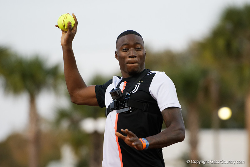 Florida Gators track star Grant Holloway throws the first pitch, after shaking first shaking off the call, as the Gators hosted Team USA at Katie Seashole Pressly Stadium Gainesville, Florida on February 11th, 2020 (Photo by David Bowie/Gatorcountry)