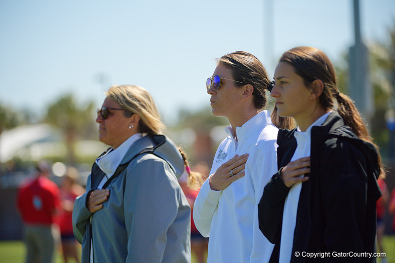 Florida Gators womens lacrosse head coach Amanda O'Leary,Florida Gators womens lacrosse assistant head coach Taryn VanThof and Florida Gators womens lacrosse assistant head coach Nadine Hadnagy during the national anthem as the #8 ranked Gators come from behind to beat the #3 ranked Stony Brook Seawolves 12-10 at Donald R. Dizney Stadium in Gainesville, Florida on February 29th, 2020 (Photo by David Bowie/Gatorcountry)