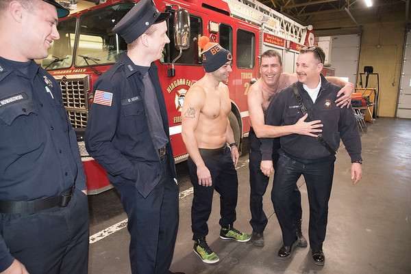 James Neiss/staff photographer <br /> Niagara Falls, NY - Niagara Falls Fire Department Battalion Chief Mark Fontanella, a stickler for requiring his crew to be presentable and properly dressed is greeted on his last day with a crew less so, with untucked or no shirts like firefighters Lauwrence Quarcini and Joe Kinney. It was all in good fun to give a well liked brother in arms a proper sendoff.