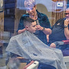James Neiss/staff photographer <br /> Town of Niagara, NY - Young Blakely Dodge, 9 of Lewiston, got a little off the top and a few snips around the ears at Gayle's Barber Shop on Military Road from Master Barber Lorena Cap.