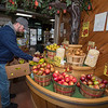 James Neiss/staff photographer <br /> Lockport, NY - Stock Clerk Eric Yaeger keeps the produce department filled with locally grown apples at Niagara Produce in Lockport. Local growers keep apples harvested in the fall, in a controlled environment for when needed at a store.