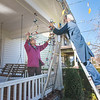 201112 Enterprise 2<br /> James Neiss/staff photographer <br /> Lockport, NY - Tis the season at the Pine Street home of Roxanne and Keith Wallace, who took advantage of the mild November day to string their Christmas lights outside.