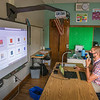 200910 NF First Day 2<br /> James Neiss/staff photographer <br /> Niagara Falls, NY - Third grade teacher Daniel Giancola prepares his work station for remote teaching over the internet with students at home.