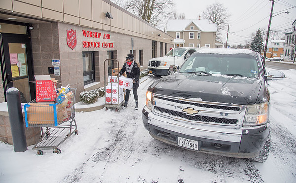 201217 Salvation Army 2<br /> James Neiss/staff photographer <br /> Lockport - Youth Services Coordinator Leah Brown and a host of volunteers distributed food to families in need for the Lockport Salvation Army's Christmas assistance program. Over 130 families have applied and qualified for the program. Food items include chicken, turkey and ham, as well as toys for children.