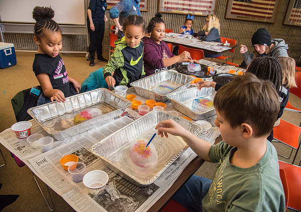 "James Neiss/staff photographer <br /> Niagara Falls, NY - Twins Nazariah & Zy'mere Bradley, both 7, their sister Layahja, 11, and Tucker Grag, 9, right, take part in the The Niagara Falls Public Library ""At The Library After School"" program titled Wintery Science,  where they learned about the freezing point of water, why salt melts ice and made icy artwork using what they learned. The At The Library After School programs are every Tuesday at 2:30 p.m. and the theme next Tuesday is Funky Cat Art."
