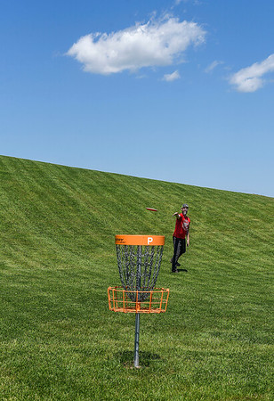 200601 Enterprise 1<br /> James Neiss/staff photographer <br /> Sanborn, NY - On Trajectory - Brad Lash of the Town of Tonawanda makes a basket during a round of Disk Golf at the Bond Lake Disk Golf course.