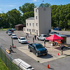 200812 County PPE 3<br /> James Neiss/staff photographer <br /> Lockport, NY - Cars lined up well past the Sheriff Department parking lot for free cloth face masks and hand sanitizer handed out by Niagara County Emergency Services staff at the Public Safety Training Facility on the Niagara Street Extension.