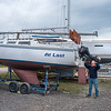 200507 Enterprise 1<br /> James Neiss/staff photographer <br /> Olcott, NY - Roy Anderson installs a motor on the At Last, a 25 foot Catalina sailboat, at the Olcott Yacht Club in preparation for the 2020 sailing season.