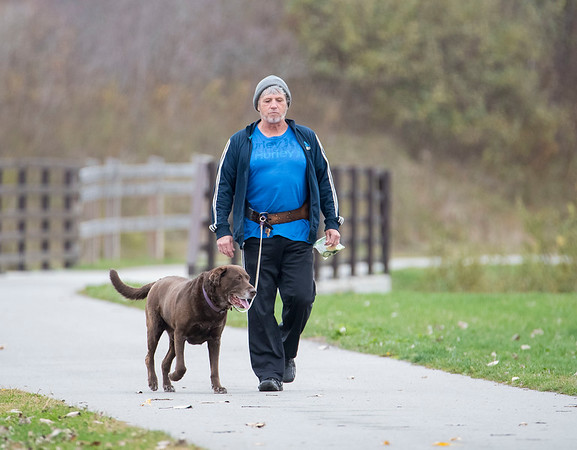 201027 Enterprise	 <br /> James Neiss/staff photographer <br /> Lockport, NY - Hands Free - Herkimer the dog takes his master Steven Erhart for a walk on the paths along the Erie Canal in Lockport. Erhart said he's been walking with his dog hands free for years.