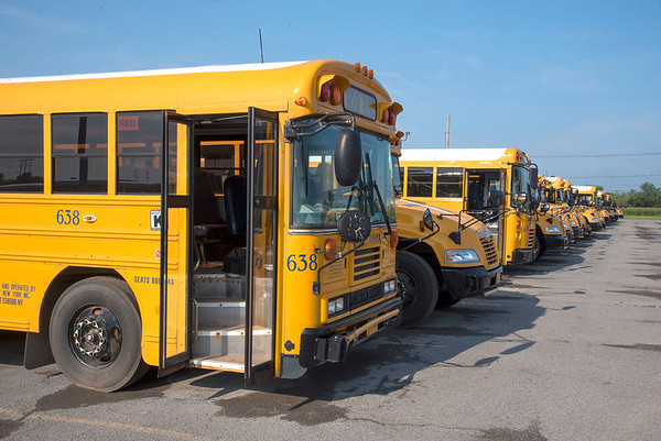 200825 School Busses 1<br /> James Neiss/staff photographer <br /> Lockport, NY - Ridge Road Express school busses are all lined up and ready to go for the start of the new school year. When and what school districts will open are still uncertain during the Covid -19 pandemic.