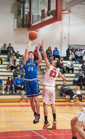 James Neiss/staff photographer <br /> Sanborn, NY - Newfane #24 Connor MacEvoy puts the ball up during basketball game action against Niagara-Wheatfield.