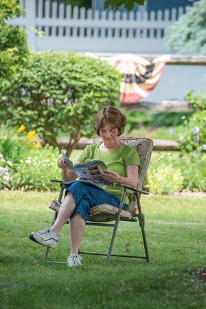 200622 Enterprise 5<br /> James Neiss/staff photographer <br /> Lockport, NY - Anna Beth Kinyon gets a little light reading in enjoying the beautiful summer weather in her Windermere Road yard.