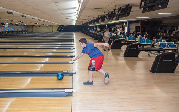 200817 Enterprise 4<br /> James Neiss/staff photographer <br /> Lockport, NY - Luke Mariani, 11, enjoyed the afternoon bowling with his father Marc at the now open Allie Brandt Lanes on Lincoln Ave.