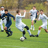 201029 NF VS NT 1<br /> James Neiss/staff photographer <br /> Niagara Falls, NY - Eye on the prize - Niagara Falls #10 Cam Sample, North Tonawanda #9 Max Waliszewski and #4 Alex Bolsover keep their eye on the ball during soccer game action in Niagara Falls.