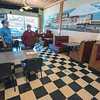 2006016 Inside Dining 2<br /> James Neiss/staff photographer <br /> Lockport, NY - Tom's Diner owners Rick and Kris Strassburg reduced the seating capacity to 50% inside their restaurant. On Tuesday New York State entered Phase 3 of reopening during the COVID-19 pandemic which includes inside dining at 50% capacity.