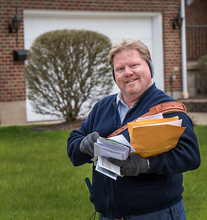 200508 HOME David Boal 2<br /> James Neiss/staff photographer <br /> North Tonawanda, NY - Postman David Boal, president of National Association of Letter Carriers, Branch 661, delivers the mail along Sherwood Avenue in North Tonawanda.