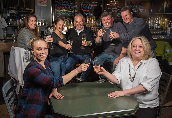 James Neiss/staff photographer <br /> Town of Niagara, NY - Judi Justiana of Judi's Lounge Bar & Grill, right, gets a toast from her daughter Maria, left, along with staff and patrons behind. Judi's Lounge Bar & Grill at 2057 Military Road are celebrating 40 years in business.
