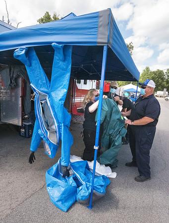 200901 Safety Expo 2<br /> James Neiss/staff photographer <br /> Lewiston, NY - Christine Brueckner with Niagara County Hazmatt, left, talks about HazMat safety equipment at Mount Saint Mary's Safety & Preparedness Expo.