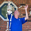 200923 Enterprise 5<br /> James Neiss/staff photographer <br /> Pendleton, NY - Mike Preston gets into the halloween spirit as he decorates his Aiken Road front porch.