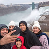 James Neiss/staff photographer <br /> Niagara Falls, NY - The Florez family, from left, Jose, Angie, Manuel, Oscar and Ana Moncada, take a selfie at Niagara Falls State Park. The family,  Colombian nationals, now Tampa Florida residents, said this is a great time to travel and they have little fear for the virus.