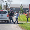200505 Food Giveaway 1<br /> James Neiss/staff photographer <br /> Town of Niagara, NY - Workers at Niagara Charter, from left, Vincent Wright, Elanda Harris, Kelsey Jung and Mackenzie Jones, deliver food to a waiting vehicle. Niagara Charter School, in partnership with Feedmore WNY,  were giving out emergency food kits to needy individuals and families at the school, located at 2077 Lockport Road.