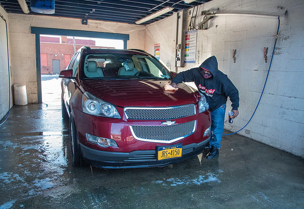 201229 Enterprise 1<br /> James Neiss/staff photographer <br /> Niagara Falls - Argo Price puts on the finishing shine after washing his car at the carwash on 11th Street.