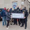 201214 Police Donation<br /> James Neiss/staff photographer <br /> Lockport, NY -  Lockport Police Lt. Marshall Belling, right, presented two checks on behalf of the Lockport Police Department – one to Roswell Park and their Beards for Bucks fundraiser – and another to the Lockport Salvation Army. The department has been asking officers to donate $50 to the fund and as a perk are growing beards and wearing earrings. This is the 7th year the department has done this, and this time raised over $1,300 to split in half for the two organizations. Participants from left are, Alex Sanchez with the Lockport Salvation Army, Mackenzie Giancarlo with Roswell Park, Lockport officers Aaron Belling, Rick Provenzano, Aric Morgan, Henry Nevins, Marshall Taylor and LT. Marshall Belling.