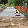 200903 Enterprise 2<br /> James Neiss/staff photographer <br /> Niagara Falls, NY - It was one paver at a time for Todd Allen of A-1 Land Care installing a walkway to the Hyde Park Rose Garden.