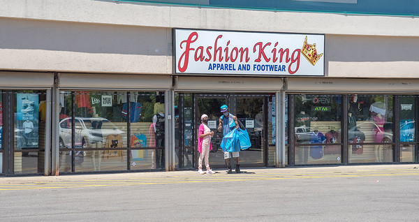 200609 NF Open Enterprise 2<br /> James Neiss/staff photographer <br /> Niagara Falls, NY - Sally Cornelious and her son Timothy enjoyed a little retail therapy buying new shoes at the Fashion King on Portage Road. Customers are returning to shopping at retail stores as COVID-19 Pandemic restrictions are raised.